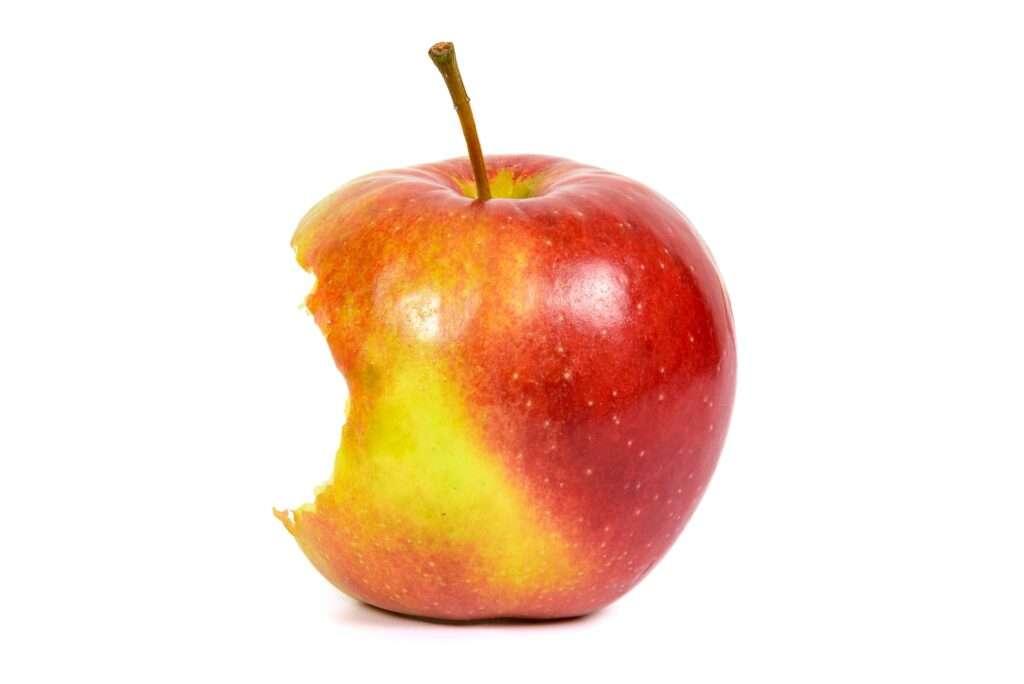 Bitten red apple on white background